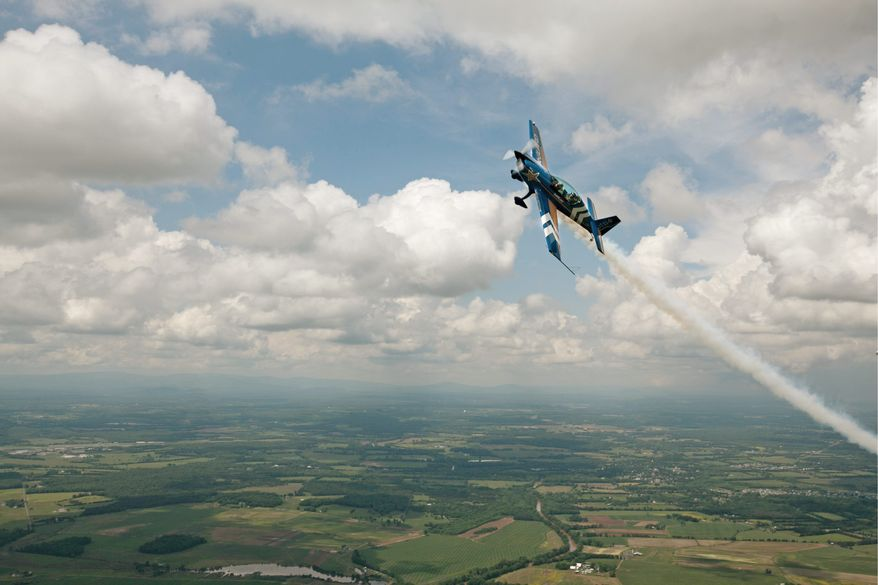 ANDREW S. GERACI / THE WASHINGTON TIMES Lt. Col. John Klatt practices an acrobatic maneuver over Manassas, Va. The Air National Guard pilot is part of this weekend's Joint Service Open House and Airshow at Andrews Air Force Base. The Air Force Thunderbirds air demonstration squadron and the Army Golden Knights parachute team are among the attractions.
