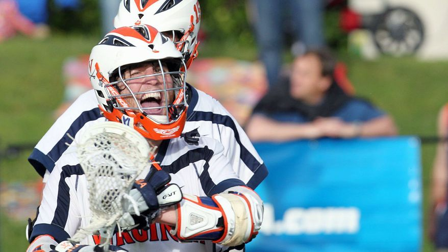 MATT RILEY/UNIVERSITY OF VIRGINIA Matt White scored in sudden death overtime to give Virginia a 13-12 win over Bucknell in the first round of the NCAA tournament last Sunday.