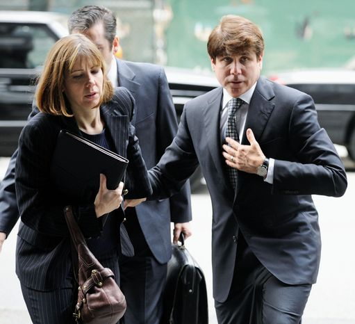 ASSOCIATED PRESS Former Illinois Gov. Rod R. Blagojevich and wife Patti arrive at court earlier this month for his second trial in Chicago. Blagojevich, who was convicted of one count of lying to the FBI in his original trial, faces 20 federal counts at his second trial.