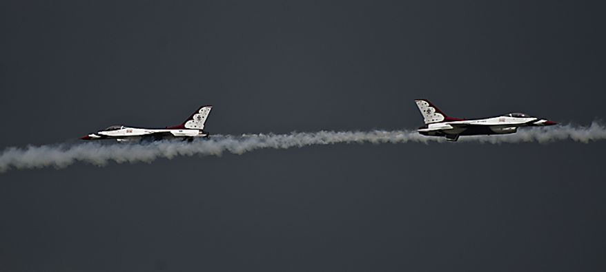 The U.S. Air Force Thunderbirds run practice flights at Andrews Air Force Base, in advance of the upcoming Joint Services Open House and Air Show, Thursday, May 19, 2011. (Drew Angerer/The Washington Times)