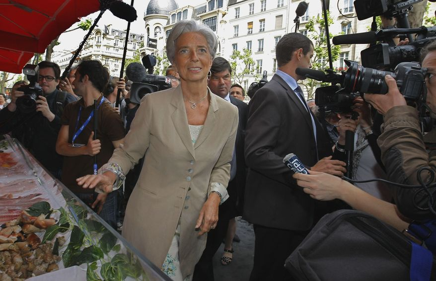 Christine Lagarde, France's finance minister, visits a Paris supermarket and goods retailer on Thursday, May 19, 2011. Ms. Lagarde has emerged as a potential candidate to replace Dominique Strauss-Kahn, who has resigned as IFM managing director. (AP Photo/Jacques Brinon)