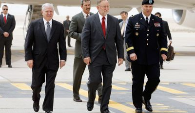 ** FILE ** U.S. Defense Secretary Robert M. Gates (left), U.S. Ambassador to Saudi Arabia James Smith (center) and U.S. Army Maj. Gen. Robert G. Catalanotti walk across an airport tarmac in Riyadh, Saudi Arabia, on Wednesday, April 6, 2011. (AP Photo/Chip Somodevilla, Pool)