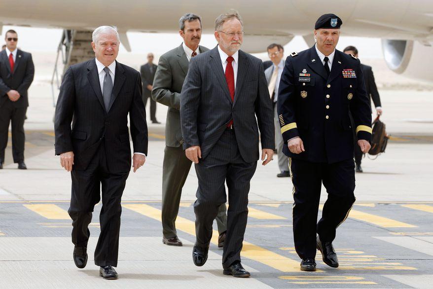 ** FILE ** U.S. Defense Secretary Robert M. Gates (left), U.S. Ambassador to Saudi Arabia James Smith (center) and U.S. Army Maj. Gen. Robert G. Catalanotti walk across an airport tarmac in Riyadh, Saudi Arabia, on Wednesday, April 6, 2011. (AP Photo/Chip Somodevilla, Pool)