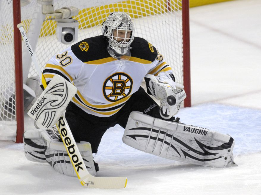 NHL Playoffs: Boston Bruins' Tim Thomas blanked the Tampa Bay Lightning in Game 3 to lead the Bruins to a 2-0 victory. Boston leads the series 2-1. (AP Photo/Phelan M. Ebenhack)