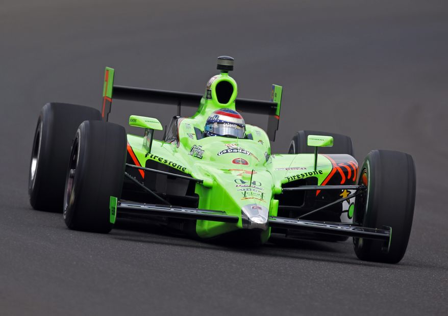 IndyCar driver Danica Patrick drives through the first turn during practice for the Indianapolis 500 at the Indianapolis Motor Speedway in Indianapolis, Thursday, May 19, 2011. This may be her last Indianapolis 500 race as there are rumors linking her to NASCAR. (AP Photo/Michael Conroy)