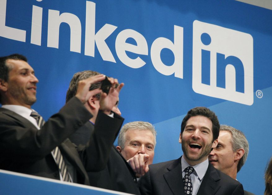 Jeff Weiner (second from right), LinkedIn's CEO, celebrates the company's listing on May 19, 2011, at the New York Stock Exchange. LinkedIn, based in Mountain View, Calif., is an internet-based social networking rolodex for business people. (Associated Press)