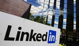 LinkedIn Corp., the professional networking Web site, displays its logo outside of headquarters in Mountain View, Calif., on May 9, 2011. (Associated Press) ** FILE **