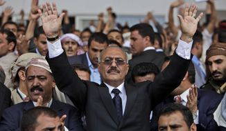 **FILE** Yemeni President Ali Abdullah Saleh waves to his supporters during a rally in Sanaa, Yemen, on April 15, 2011. (Associated Press)