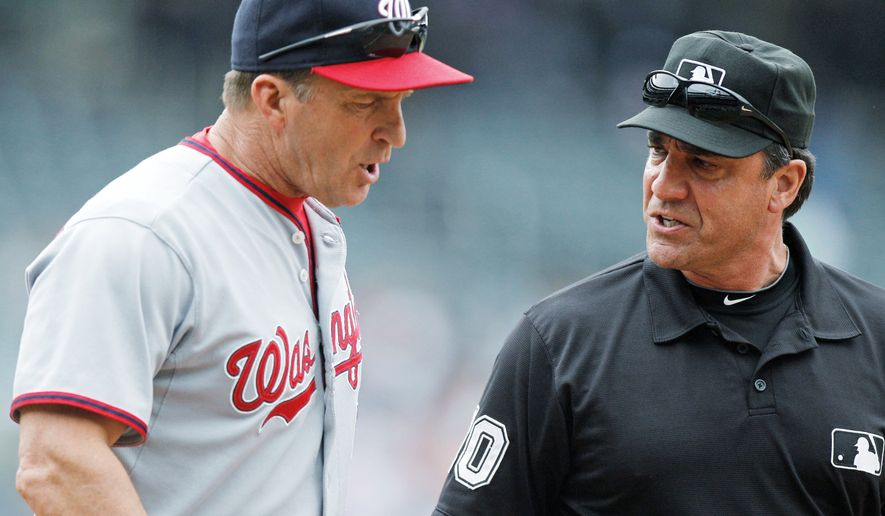 Washington Nationals manager Jim Riggleman, left, argues with first base umpire Phil Cuzzi during the ninth inning of a baseball game against the New York Mets Thursday, May 19, 2011, at Citi Field in New York. The Nationals lost the game 1-0. (AP Photo/Frank Franklin II)