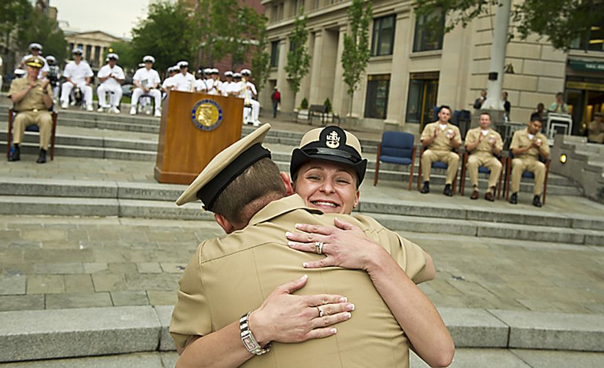 USN PR1 (AW/SW) Amy E. Davis (right) gets a hug from her husband USN PRC(AW/SW/FPJ) David B. Davis (left) after receiving her pin and award during the Sailor of the Year 2010 ceremony at the U.S. Navy Memorial in Washington, D.C., Thursday, May 19, 2011. The Sailor of the Year program began in 1972 to recognize the outstanding Sailors of the Atlantic and Pacific Fleets. (Rod Lamkey Jr./The Washington Times)