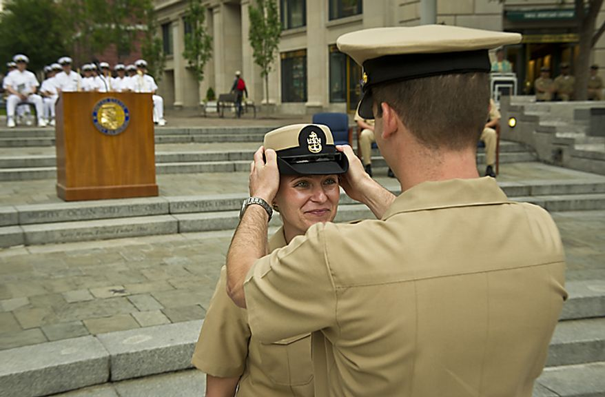 USN PR1 (AW/SW) Amy E. Davis (left) has her cap placed upon her by her husband USN PRC(AW/SW/FPJ) David B. Davis (right)after receiving her pin and award during the Sailor of the Year 2010 ceremony at the U.S. Navy Memorial in Washington, D.C., Thursday, May 19, 2011. (Rod Lamkey Jr./The Washington Times)