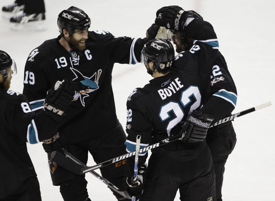 NHL Playoffs: San Jose Sharks defenseman Dan Boyle (22) is congratulated by teammates after scoring against the Vancouver Canucks during the third period of Game 3 of the NHL Stanley Cup playoffs Western Conference final hockey series Friday, May 20, 2011, in San Jose, Calif. (AP Photo/Paul Sakuma)
