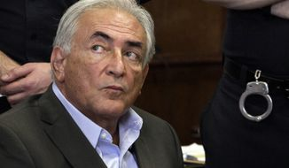 Former International Monetary Fund leader Dominique Strauss-Kahn listens on May 19, 2011, to proceedings in his case in New York state Supreme Court. (Associated Press)