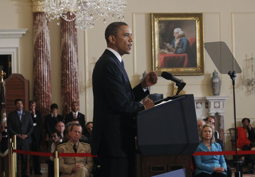 President Obama delivers a speech on the Middle East at the State Department in Washington on Thursday, May 19, 2011. Secretary of State Hillary Rodham Clinton is seated at right, and Adm. Mike Mullen, chairman of the Joint Chiefs of Staff, is seen at left. (Associated Press)