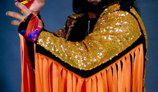 """In this undated publicity image released by WWE, professional wrestler Randy """"Macho Man"""" Savage is shown. Savage, whose legal name is Randy Mario Poffo, died in a car crash in Florida on Friday, May 20, 2011, according to a Florida Highway Patrol crash report. (AP Photo/WWE)"""