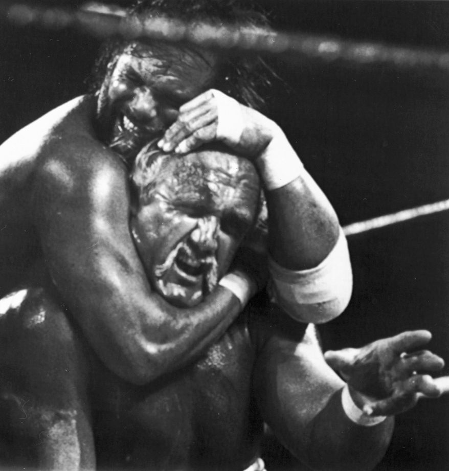 """** FILE ** In this April 4, 1989, file photo, Randy """"Macho Man"""" Savage, top, has challenger Hulk Hogan in a headlock during the main event for Wrestlemania V in Atlantic City, N.J. Savage, whose legal name is Randy Mario Poffo, died in a car crash in Florida on Friday, May 20, 2011, according to a Florida Highway Patrol crash report. (AP Photo/B. Vartan Boyajian, File)"""