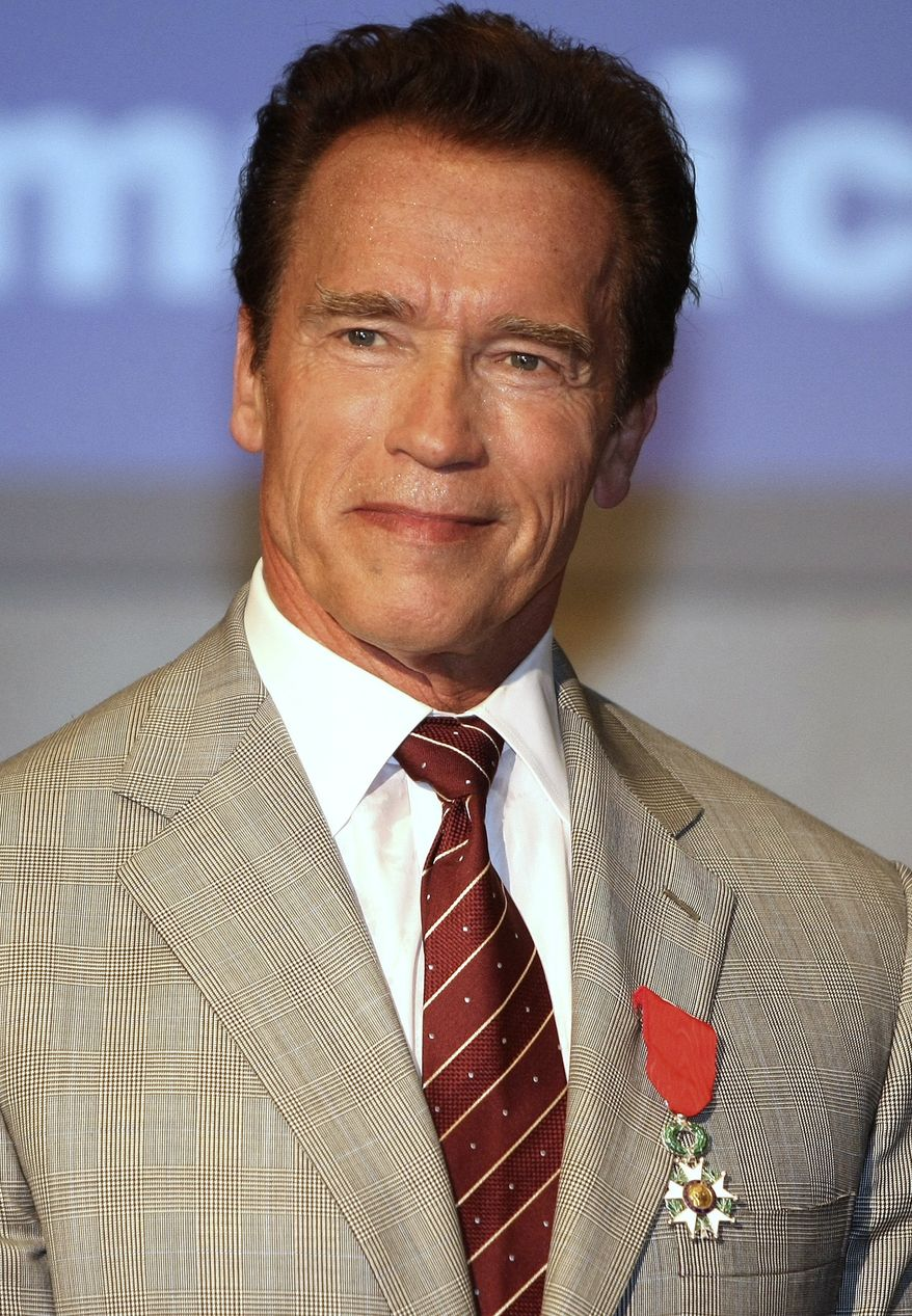 ** FILE ** In this April 4, 2011, file photo, actor and former California Gov. Arnold Schwarzenegger, poses after receiving the insignia of Chevalier in the Order of the Legion of Honor during the MIPTV (International Television Programme Market) in Cannes, southern France. (AP Photo/Lionel Cironneau, File)