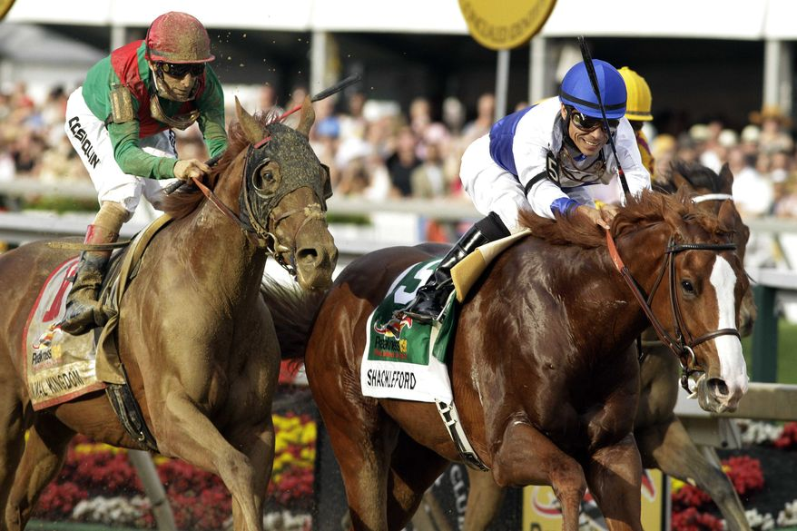 Preakness: Shackleford, front right, ridden by Jesus Castanon, moves to the finish line to win the 136th Preakness Stakes horse race at Pimlico Race Course, Saturday, May 21, 2011, in Baltimore. Animal Kingdom, left, ridden by John Velazquez, took second place. (AP Photo/Garry Jones)
