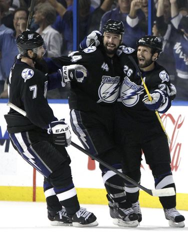 NHL Playoffs: Tampa Bay Lightning right wing Martin St. Louis (26) celebrates with teammates Nate Thompson (44) and Brett Clark (7) after scoring a goal against the Boston Bruins during the third period in Game 4 of the NHL hockey Stanley Cup playoffs Eastern Conference finals, Saturday, May 21, 2011 in Tampa, Fla. Tampa Bay won 5-3. (AP Photo/Chris O'Meara)