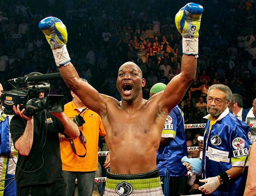 "ASSOCIATED PRESS Bernard Hopkins, 46, celebrated after defeating Jean Pascal to capture the WBC light heavyweight title in Montreal on Saturday night. ""I won't retire until I'm 50,"" Hopkins said after his victory."