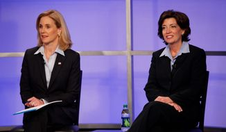 The major-party candidates for New York's 26th Congressional District, Republican Jane Corwin (left) and Democrat Kathy Hochul, participate in a debate May 12. They and an independent are vying in a special election Tuesday.