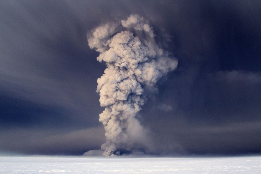 Smoke and ash rise from Iceland's Grimsvotn volcano, which lies under the Vatnajokull glacier, about 120 miles east of the capital, Rejkjavik, on Saturday, May 21, 2011. (AP Photo, Jon Gustafsson)