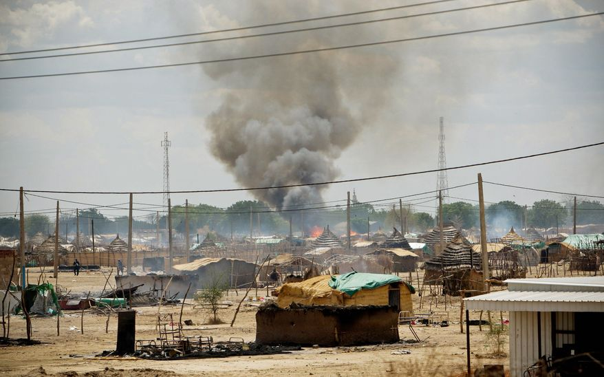 Homes burn in Abyei, Sudan, on Monday. Armed men burned and looted the disputed oil-rich province on Monday, the U.N. mission there said. (Associated Press)