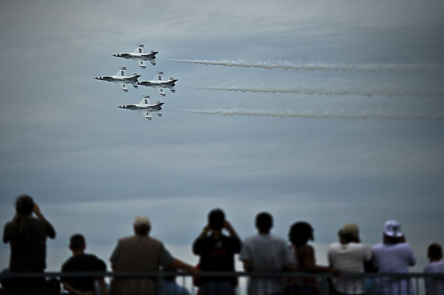 U.S. Air Force Thunderbirds fly in formation as the crowd watches during the Open House and Air Show at Andrews Air Force Base, Sunday, May 22, 2011. (Drew Angerer/The Washington Times)
