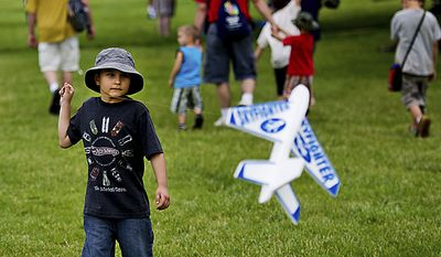 Kamron Hinton, 7, of Laurel, flies a foam airplane kite during the Open House and Air Show at Andrews Air Force Base, Sunday, May 22, 2011. (Drew Angerer/The Washington Times)