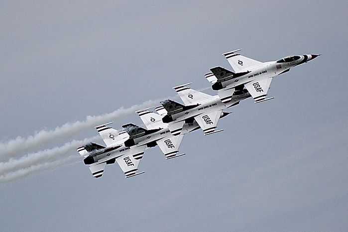 ** FILE ** The U.S. Air Force Thunderbirds demonstration team performs stunts for the crowd during the open house and air show at Andrews Air Force Base outside Washington on Sunday, May 22, 2011. (The Washington Times)