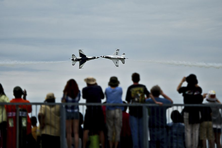 U.S. Air Force Thunderbirds perform stunts for the crowd during the Open House and Air Show at Andrews Air Force Base, Sunday, May 22, 2011. (Drew Angerer/The Washington Times)