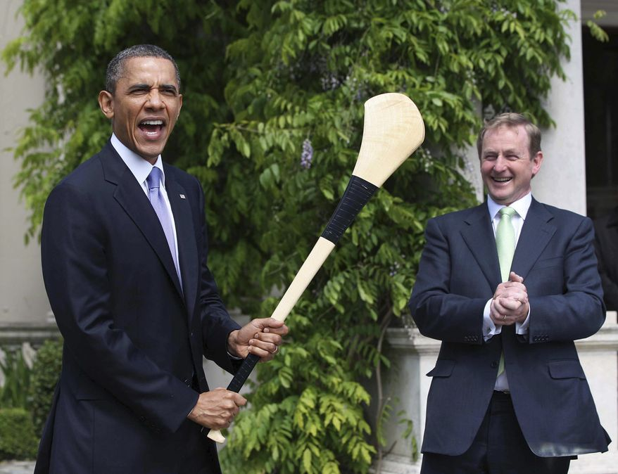 President Obama (left) reacts after he was presented with a hurley stick from Irish Prime Minister and Taoiseach Enda Kenny while in Farmleigh, Dublin, on May 23, 2011. (Associated Press)