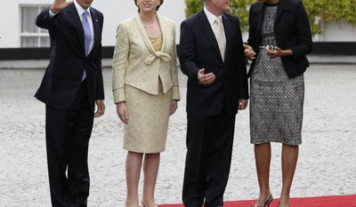 Irish President Mary McAleese (second from left) and her husband, Martin McAleese (second from right), welcome President Obama and first lady Michelle Obama to Ireland at the presidential residence in Dublin on Monday, May 23, 2011. (AP Photo/Carolyn Kaster)