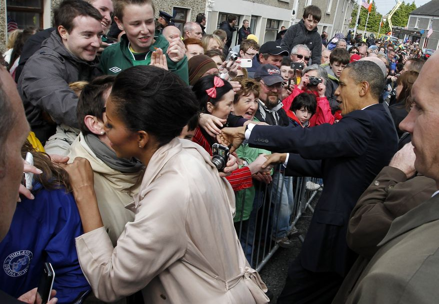 President Obama and first lady Michelle Obama greet residents of Moneygall, Ireland, the ancestral homeland of his great-great-great-grandfather, on Monday, May 23, 2011. (AP Photo/Charles Dharapak)