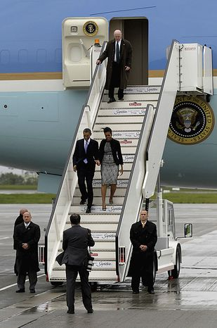 U.S. President Barack Obama and first lady Michelle Obama disembark from Air Force One as they arrive at Dublin Airport to begin a 24-hour visit to the Republic of Ireland, in Dublin, Monday, May 23, 2011.  President Barack Obama opens a six-day European tour with a quick dash through Ireland, where he will celebrate his own Irish roots and look to give a boost to a nation grappling with the fallout from its financial collapse.  (AP Photo/Matt Dunham)