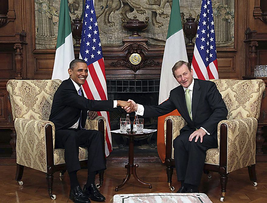 """US President Barack Obama, left, and Taoiseach Enda Kenny shake hands during talks in Farmleigh, Dublin Monday May 23, 2011. President Barack Obama said Monday that the U.S. and Ireland share a """"blood link"""" that extends beyond strategic interests or foreign policy into the hearts of the millions of Irish Americans who still see a homeland here. (AP Photo, Pool)"""