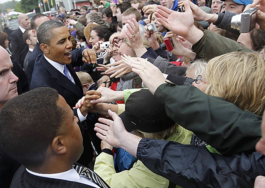 U.S. President Barack Obama greets local residents in Moneygall, Ireland, the ancestral homeland of his great-great-great grandfather, Monday, May 23, 2011. (AP Photo/Charles Dharapak)