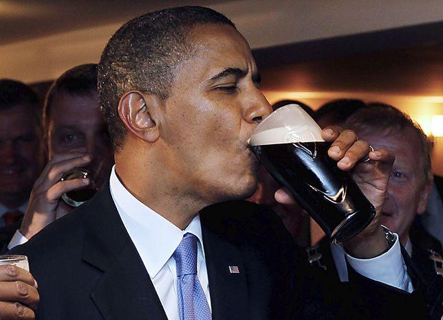 ** FILE ** U.S. President Barack Obama drinks Guinness beer at Ollie Hayes pub in Moneygall, Ireland, May 23, 2011. (AP Photo/Charles Dharapak)