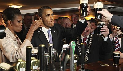 President Obama and first lady Michelle Obama drink Guinness stout as they meet with local residents at Ollie Hayes' pub in Moneygall, Ireland, the ancestral homeland of his great-great-great grandfather, on Monday, May 23, 2011. (AP Photo, Pool)