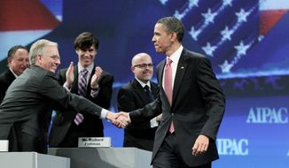 MOVERS AND SHAKERS: President Obama greets Michael Kassen, a member of the AIPAC National Board of Directors. Mr. Kassen began his term as president-elect during the conference. (Associated Press)