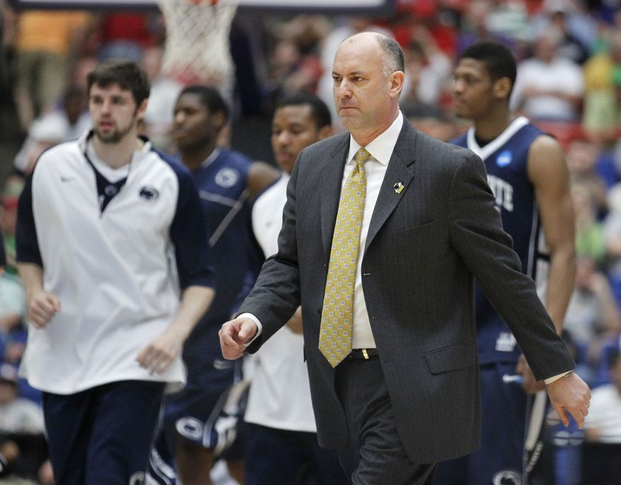 In this March 17, 2011, photo, Penn State coach Ed DeChellis walks with his players during a West Regional NCAA college basketball tournament game in Tucson, Ariz. DeChellis, who led Penn State to the NCAA tournament this year, has resigned to take the vacant job at Navy, according to a person in the Penn State athletic department familiar with the situation. The person spoke to The Associated Press on Monday, May 23, 2011, on condition of anonymity because DeChellis' resignation has not been publicly announced by the university. (AP Photo/Chris Carlson)