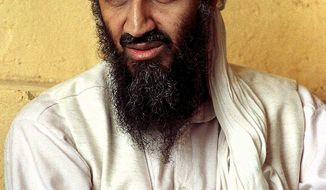 FILE--Exiled Saudi dissident Osama bin Laden is seen in Afghanistan in this April 1998 file photo. U.S. authorities are investigating whether four separate cells of terrorists were involved in Tuesday's devastating attacks. At least one set of hijackers is believed to have crossed from Canada and had ties to Bin Laden, law enforcement officials said Wednesday, Sept. 12, 2001. (AP Photo)
