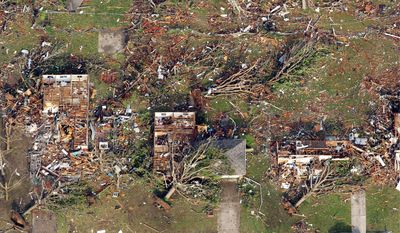 "The tornado damage was ""like taking a mower through tall grass,"" state Sen. Ron Richard said of the destruction in Joplin, Mo. The storm tore across the city Sunday, killing at least 116 people. (Associated Press)"