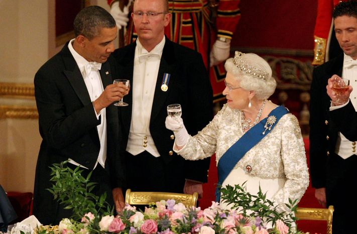 Britain's Queen Elizabeth II and Mr. Obama toast at a state banquet in London's Buckingham Palace on Tuesday. Mr. Obama brought gifts for the queen and other members of the British royal family. (Associated Press)