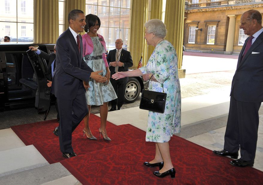 Queen Elizabeth II (second from right) and her husband, Prince Philip (right), greet President Obama and his wife, first lady Michelle Obama, upon the Obamas' arrival at Buckingham Palace in central London on Tuesday, May 24, 2011. (AP Photo/Toby Melville, Pool)