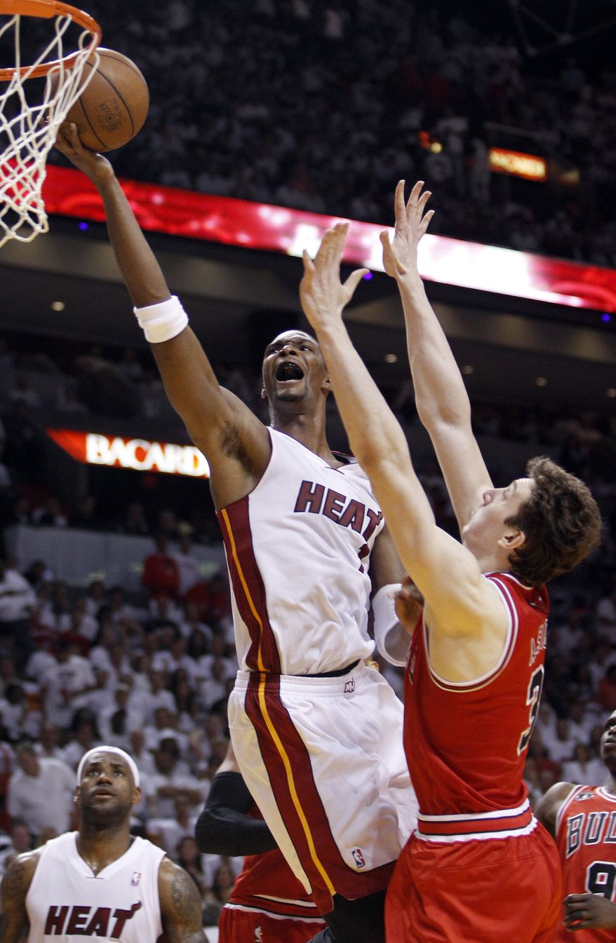 NBA Playoffs: Miami Heat's Chris Bosh goes for a basket over Chicago Bulls' Omer Asik during the first half of Game 4 of the NBA Eastern Conference finals basketball series in Miami, Tuesday, May 24, 2011. (AP Photo/Lynne Sladky)