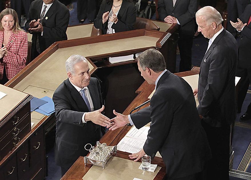 Israel's Prime Minister Benjamin Netanyahu reaches to shakes hand with House Speaker John Boehner of Ohio as Vice President Joe Biden looks on, on Capitol Hill in Washington, Tuesday, May 24, 2011, after his address to a joint meeting of Congress. (AP Photo/J. Scott Applewhite)