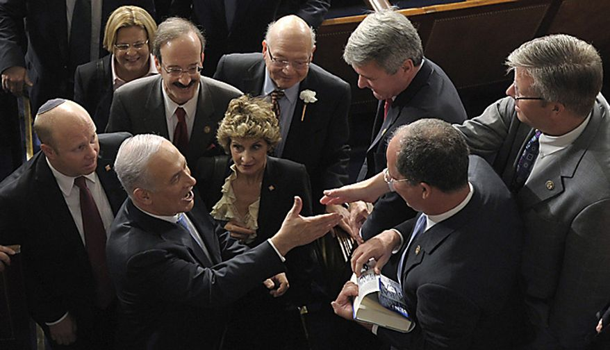 Israeli Prime Minister Benjamin Netanyahu greets people on Capitol Hill in Washington, Tuesday, May 24, 2011, after addressing a joint meeting of Congress. (AP Photo/Susan Walsh)