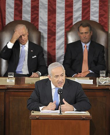 Israel's Prime Minister Benjamin Netanyahu gestures while addresses a joint meeting of Congress on Capitol Hill in Washington, Tuesday, May 24, 2011. House Speaker House John Boehner of Ohio, right, and Vice President Joe Biden listen behind. (AP Photo/Susan Walsh)