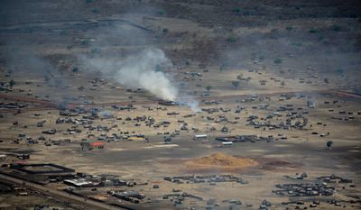 In this photo released by the U.N. Mission in Sudan (UNMIS), homes burn in the town of Abyei, Sudan, on Monday, May 23, 2011. (AP Photo/UNMIS, Stuart Price)